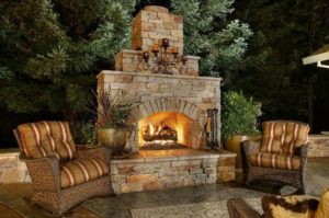 Outdoor Masonry Stone Fireplace With Cozy Chairs