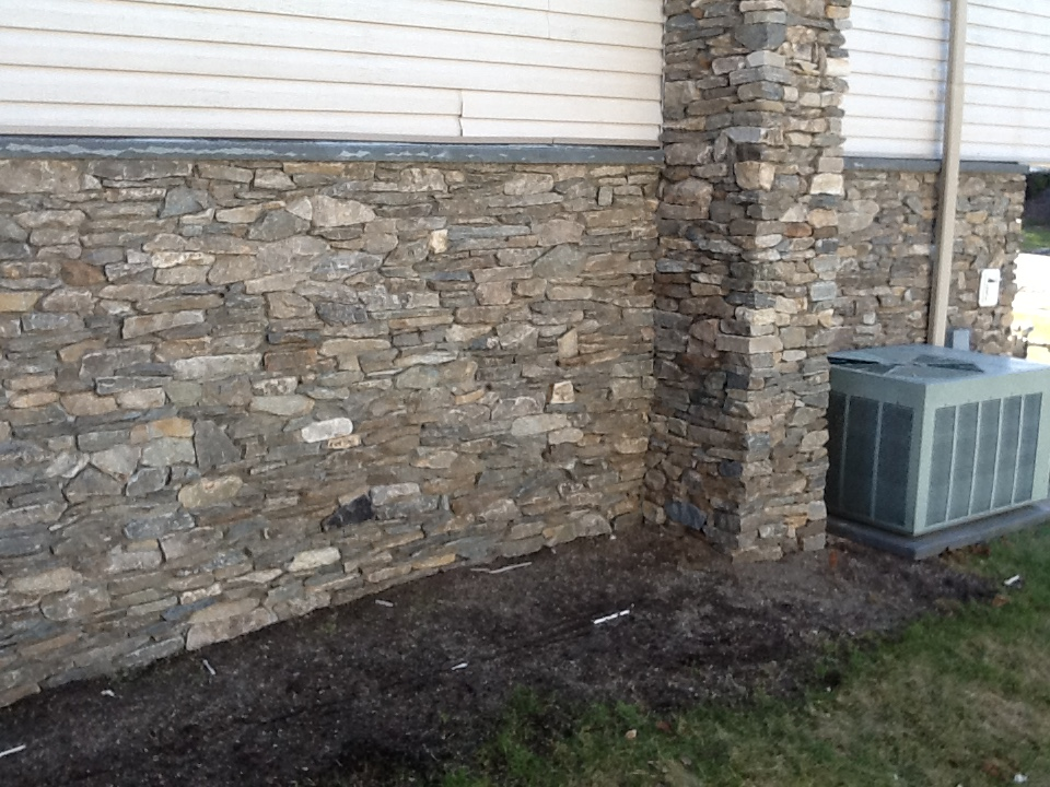 Stone Veneer Siding and Chimney